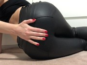 woman in leather pants shows her holes!